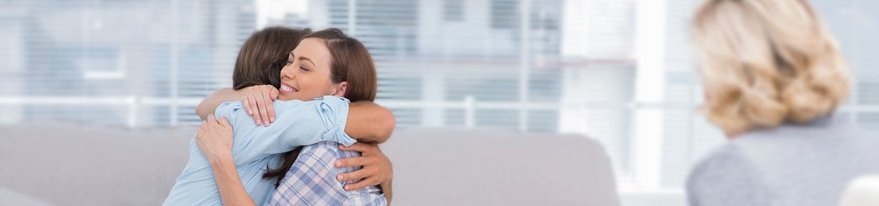 Couple hugging after a successful outcome of an injury case brought to court with the help of an expert Arlington Heights injury attorney